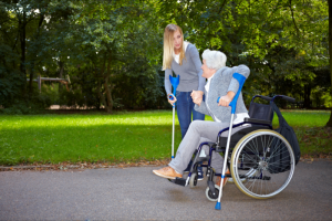 lady assisting patient to walk